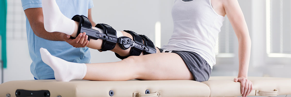 image of woman being fitted for knee brace